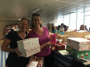 Hardworking Kellett mums Lucy Wilkinson and Amanda Dijanosic check boxes.