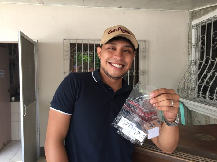 ICM's livelihood coordinator, Aldran, holds up the seeds to be distributed in his community