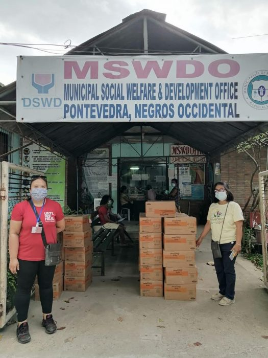 ICM staff distribute therapeutic food in Negros